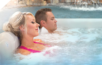 Man and woman enjoying Clarity Spas egonomically designed hot tub seats